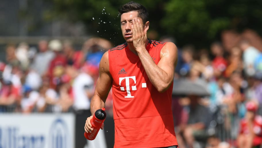 Bayern Munich's Polish striker Robert Lewandowski refreshes during a team trainings session of the German first division Bundesliga team FC Bayern Munich in the team trainings camp in Rottach-Egern, southern Germany, on August 6, 2018. (Photo by Christof STACHE / AFP)        (Photo credit should read CHRISTOF STACHE/AFP/Getty Images)