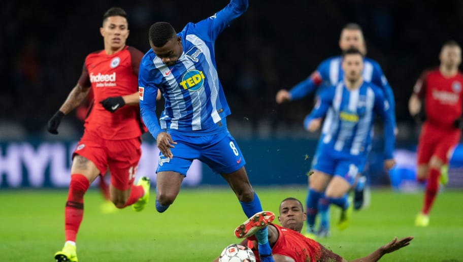 Berlin´s Ivorian midfielder Salomon Kalou (L) and Frankfurt´s Swiss midfielder Gelson Fernandes vie for the ball during the German first division Bundesliga football match between Hertha Berlin v Eintracht Frankfurt at the Olympic stadium in Berlin on December 8, 2018. (Photo by ROBERT MICHAEL / AFP) / RESTRICTIONS: DFL REGULATIONS PROHIBIT ANY USE OF PHOTOGRAPHS AS IMAGE SEQUENCES AND/OR QUASI-VIDEO        (Photo credit should read ROBERT MICHAEL/AFP/Getty Images)