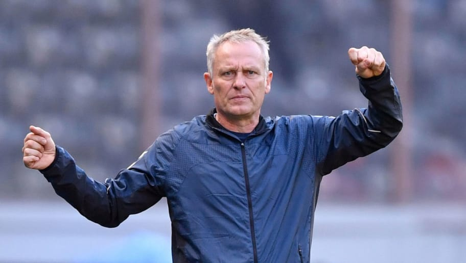 Freiburg's German head coach Christian Streich gestures during the German First division Bundesliga football match between Hertha Berlin and SC Freiburg in Berlin on October 21, 2018. (Photo by John MACDOUGALL / AFP) / DFL REGULATIONS PROHIBIT ANY USE OF PHOTOGRAPHS AS IMAGE SEQUENCES AND/OR QUASI-VIDEO        (Photo credit should read JOHN MACDOUGALL/AFP/Getty Images)