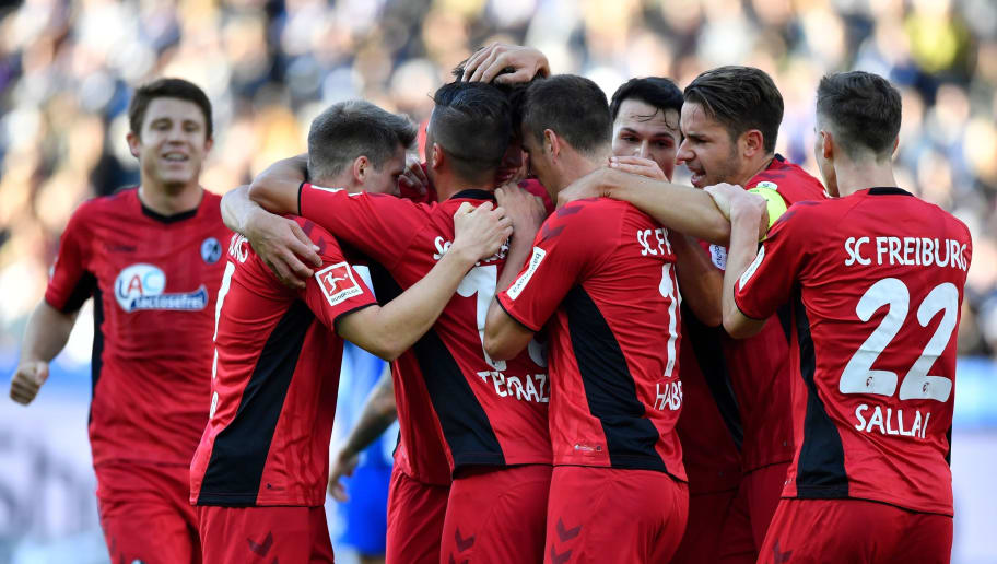 Freiburg's players celebrate after Freiburg's German defender Robin Koch (2ndL) scored a goal during the German first division Bundesliga football match Hertha Berlin vs SC Freiburg on October 21, 2018 in Berlin. (Photo by John MACDOUGALL / AFP) / RESTRICTIONS: DFL REGULATIONS PROHIBIT ANY USE OF PHOTOGRAPHS AS IMAGE SEQUENCES AND/OR QUASI-VIDEO        (Photo credit should read JOHN MACDOUGALL/AFP/Getty Images)
