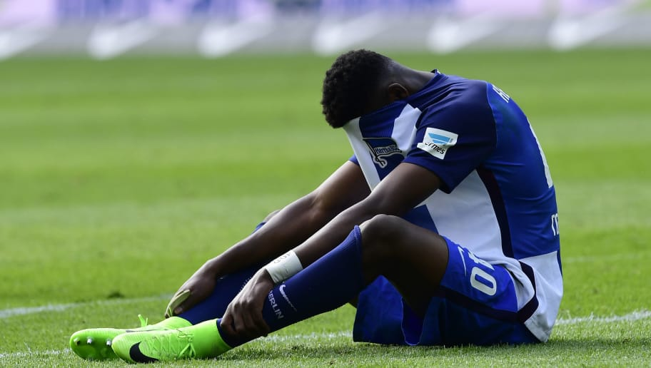 Hertha Berlin's Jordan Torunarigha reacts after the German first division football match between Hertha Berlin and Bayer 04 Leverkusen in Berlin, on May 20, 2017. / AFP PHOTO / TOBIAS SCHWARZ / RESTRICTIONS: DURING MATCH TIME: DFL RULES TO LIMIT THE ONLINE USAGE TO 15 PICTURES PER MATCH AND FORBID IMAGE SEQUENCES TO SIMULATE VIDEO. == RESTRICTED TO EDITORIAL USE == FOR FURTHER QUERIES PLEASE CONTACT DFL DIRECTLY AT + 49 69 650050  / RESTRICTIONS: DURING MATCH TIME: DFL RULES TO LIMIT THE ONLINE USAGE TO 15 PICTURES PER MATCH AND FORBID IMAGE SEQUENCES TO SIMULATE VIDEO. == RESTRICTED TO EDITORIAL USE == FOR FURTHER QUERIES PLEASE CONTACT DFL DIRECTLY AT + 49 69 650050         (Photo credit should read TOBIAS SCHWARZ/AFP/Getty Images)