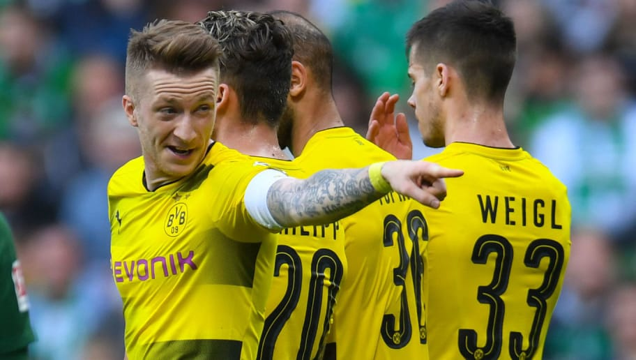 Dortmund's German forward Marco Reus reacts during the German first division Bundesliga football match of Werder Bremen versus Borussia Dortmund on April 29, 2018 in Bremen. (Photo by Patrik STOLLARZ / AFP) / RESTRICTIONS: DURING MATCH TIME: DFL RULES TO LIMIT THE ONLINE USAGE TO 15 PICTURES PER MATCH AND FORBID IMAGE SEQUENCES TO SIMULATE VIDEO. == RESTRICTED TO EDITORIAL USE == FOR FURTHER QUERIES PLEASE CONTACT DFL DIRECTLY AT + 49 69 650050        (Photo credit should read PATRIK STOLLARZ/AFP/Getty Images)