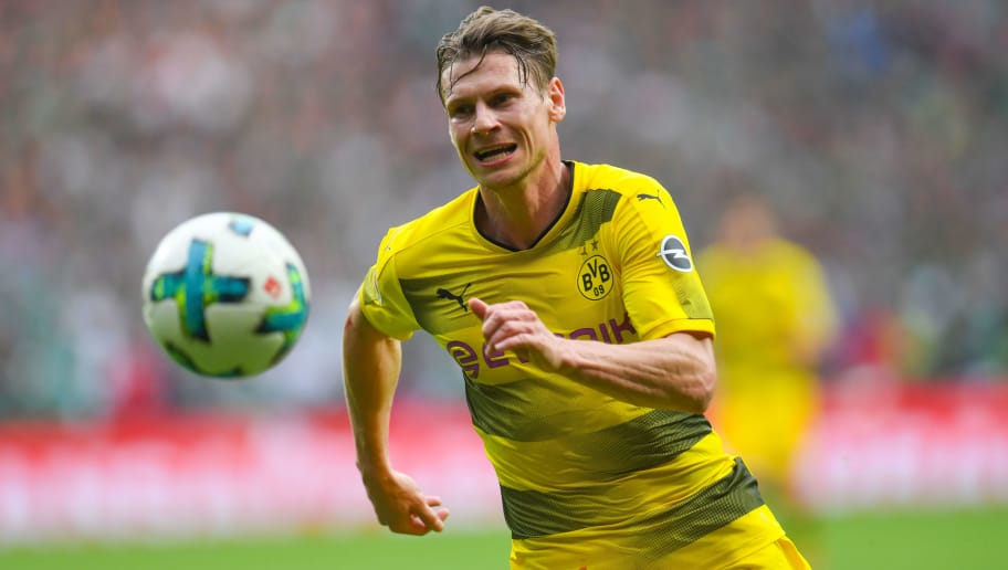 Dortmund's Polish defender Lukasz Piszczek plays the ball during the German first division Bundesliga football match of Werder Bremen versus Borussia Dortmund on April 29, 2018 in Bremen. (Photo by Patrik STOLLARZ / AFP) / RESTRICTIONS: DURING MATCH TIME: DFL RULES TO LIMIT THE ONLINE USAGE TO 15 PICTURES PER MATCH AND FORBID IMAGE SEQUENCES TO SIMULATE VIDEO. == RESTRICTED TO EDITORIAL USE == FOR FURTHER QUERIES PLEASE CONTACT DFL DIRECTLY AT + 49 69 650050        (Photo credit should read PATRIK STOLLARZ/AFP/Getty Images)