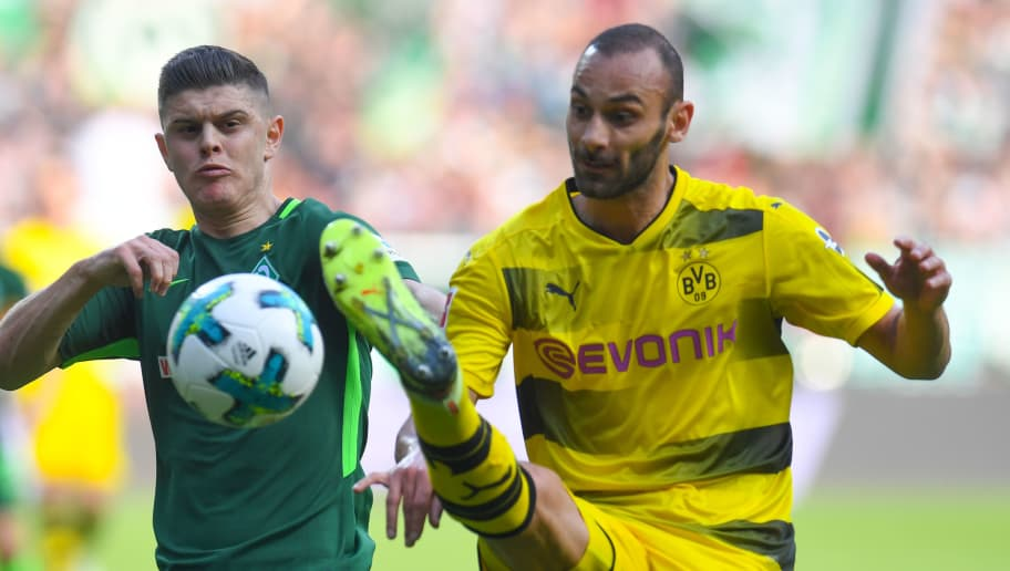 Bremen's Kosovo midfielder Milot Rashica and Dortmund's Turkish defender Omer Toprak vie for the ball  during the German first division Bundesliga football match of Werder Bremen versus Borussia Dortmund on April 29, 2018 in Bremen. (Photo by Patrik STOLLARZ / AFP) / RESTRICTIONS: DURING MATCH TIME: DFL RULES TO LIMIT THE ONLINE USAGE TO 15 PICTURES PER MATCH AND FORBID IMAGE SEQUENCES TO SIMULATE VIDEO. == RESTRICTED TO EDITORIAL USE == FOR FURTHER QUERIES PLEASE CONTACT DFL DIRECTLY AT + 49 69 650050        (Photo credit should read PATRIK STOLLARZ/AFP/Getty Images)
