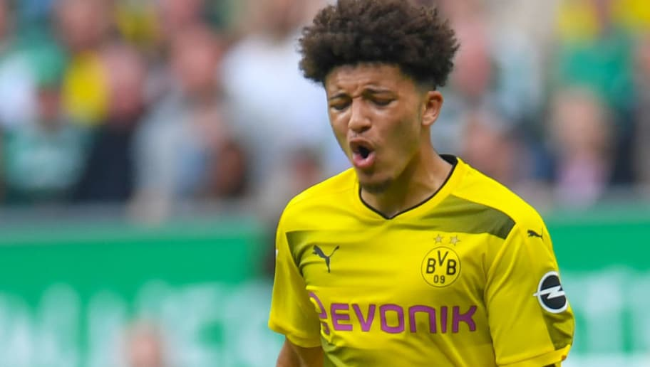 Dortmund's English midfielder Jadon Sancho plays the ball during the German first division Bundesliga football match of Werder Bremen versus Borussia Dortmund on April 29, 2018 in Bremen. (Photo by Patrik STOLLARZ / AFP) / RESTRICTIONS: DURING MATCH TIME: DFL RULES TO LIMIT THE ONLINE USAGE TO 15 PICTURES PER MATCH AND FORBID IMAGE SEQUENCES TO SIMULATE VIDEO. == RESTRICTED TO EDITORIAL USE == FOR FURTHER QUERIES PLEASE CONTACT DFL DIRECTLY AT + 49 69 650050        (Photo credit should read PATRIK STOLLARZ/AFP/Getty Images)