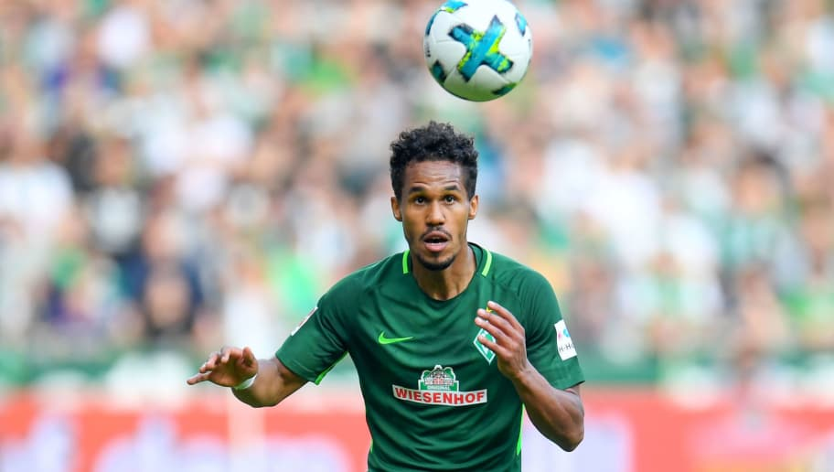 Bremen's Czech defender Theodor Gebre Selassie plays the ball during the German first division Bundesliga football match of Werder Bremen versus Borussia Dortmund on April 29, 2018 in Bremen. (Photo by Patrik STOLLARZ / AFP) / RESTRICTIONS: DURING MATCH TIME: DFL RULES TO LIMIT THE ONLINE USAGE TO 15 PICTURES PER MATCH AND FORBID IMAGE SEQUENCES TO SIMULATE VIDEO. == RESTRICTED TO EDITORIAL USE == FOR FURTHER QUERIES PLEASE CONTACT DFL DIRECTLY AT + 49 69 650050        (Photo credit should read PATRIK STOLLARZ/AFP/Getty Images)