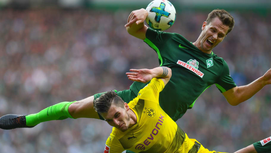 Dortmund's German forward Maximilian Philipp and Bremen's German defender Sebastian Langkamp vie for the ball during the German first division Bundesliga football match of Werder Bremen versus Borussia Dortmund n April 29, 2018 in Bremen. (Photo by Patrik STOLLARZ / AFP) / RESTRICTIONS: DURING MATCH TIME: DFL RULES TO LIMIT THE ONLINE USAGE TO 15 PICTURES PER MATCH AND FORBID IMAGE SEQUENCES TO SIMULATE VIDEO. == RESTRICTED TO EDITORIAL USE == FOR FURTHER QUERIES PLEASE CONTACT DFL DIRECTLY AT + 49 69 650050        (Photo credit should read PATRIK STOLLARZ/AFP/Getty Images)