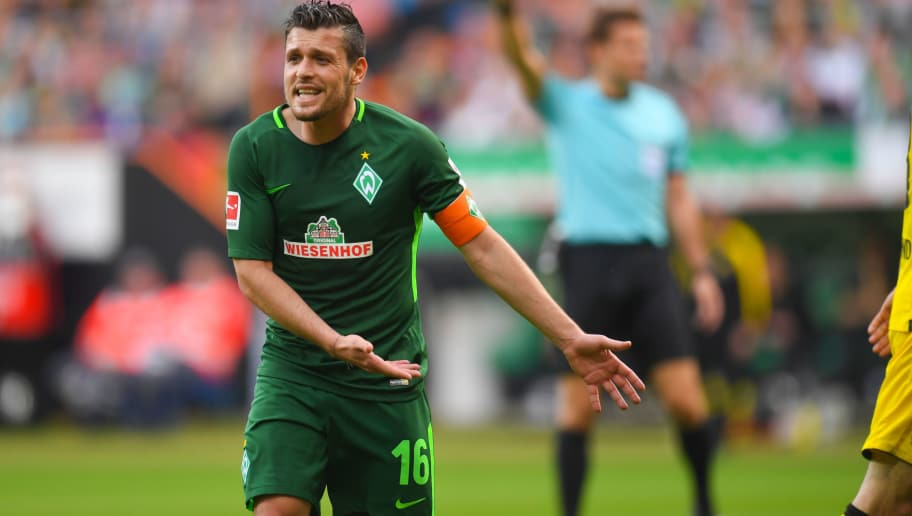 Bremen's Austrian midfielder Zlatko Junuzovic reacts during the German first division Bundesliga football match of Werder Bremen versus Borussia Dortmund on April 29, 2018 in Bremen. (Photo by Patrik STOLLARZ / AFP) / RESTRICTIONS: DURING MATCH TIME: DFL RULES TO LIMIT THE ONLINE USAGE TO 15 PICTURES PER MATCH AND FORBID IMAGE SEQUENCES TO SIMULATE VIDEO. == RESTRICTED TO EDITORIAL USE == FOR FURTHER QUERIES PLEASE CONTACT DFL DIRECTLY AT + 49 69 650050        (Photo credit should read PATRIK STOLLARZ/AFP/Getty Images)