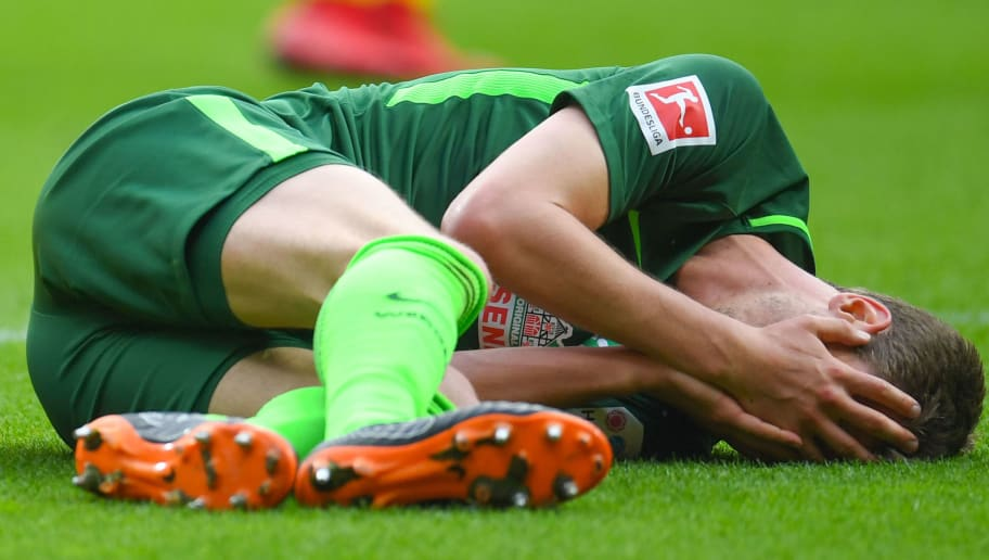 Dortmund's German forward Maximilian Philipp and Bremen's German defender Sebastian Langkamp react during the German first division Bundesliga football match of Werder Bremen versus Borussia Dortmund on April 29, 2018 in Bremen. (Photo by Patrik STOLLARZ / AFP) / RESTRICTIONS: DURING MATCH TIME: DFL RULES TO LIMIT THE ONLINE USAGE TO 15 PICTURES PER MATCH AND FORBID IMAGE SEQUENCES TO SIMULATE VIDEO. == RESTRICTED TO EDITORIAL USE == FOR FURTHER QUERIES PLEASE CONTACT DFL DIRECTLY AT + 49 69 650050        (Photo credit should read PATRIK STOLLARZ/AFP/Getty Images)
