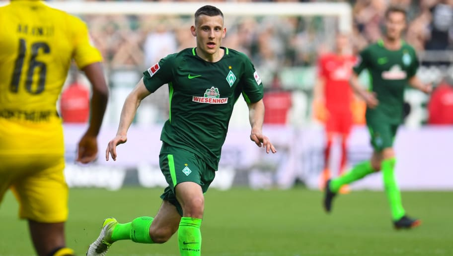 Bremen's German midfielder Maximilian Eggestein runs with the ball during the German first division Bundesliga football match of Werder Bremen versus Borussia Dortmund on April 29, 2018 in Bremen. (Photo by Patrik STOLLARZ / AFP) / RESTRICTIONS: DURING MATCH TIME: DFL RULES TO LIMIT THE ONLINE USAGE TO 15 PICTURES PER MATCH AND FORBID IMAGE SEQUENCES TO SIMULATE VIDEO. == RESTRICTED TO EDITORIAL USE == FOR FURTHER QUERIES PLEASE CONTACT DFL DIRECTLY AT + 49 69 650050        (Photo credit should read PATRIK STOLLARZ/AFP/Getty Images)