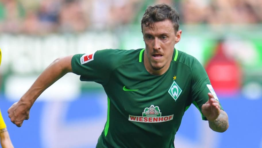 Bremen's German forward Max Kruse runs with the ball during the German first division Bundesliga football match of Werder Bremen versus Borussia Dortmund on April 29, 2018 in Bremen. (Photo by Patrik STOLLARZ / AFP) / RESTRICTIONS: DURING MATCH TIME: DFL RULES TO LIMIT THE ONLINE USAGE TO 15 PICTURES PER MATCH AND FORBID IMAGE SEQUENCES TO SIMULATE VIDEO. == RESTRICTED TO EDITORIAL USE == FOR FURTHER QUERIES PLEASE CONTACT DFL DIRECTLY AT + 49 69 650050        (Photo credit should read PATRIK STOLLARZ/AFP/Getty Images)