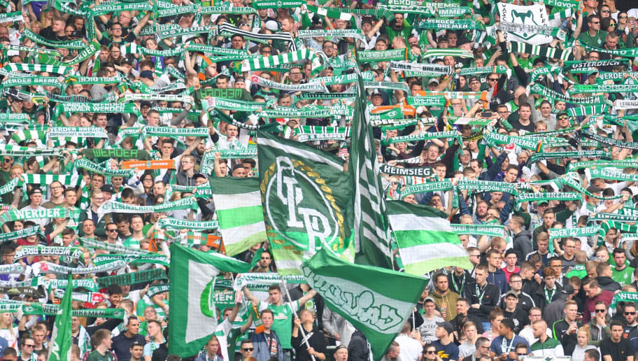 Bremen's supporters cheer up their team before the German first division Bundesliga football match of Werder Bremen versus Borussia Dortmund on April 29, 2018 in Bremen. (Photo by Patrik STOLLARZ / AFP) / RESTRICTIONS: DURING MATCH TIME: DFL RULES TO LIMIT THE ONLINE USAGE TO 15 PICTURES PER MATCH AND FORBID IMAGE SEQUENCES TO SIMULATE VIDEO. == RESTRICTED TO EDITORIAL USE == FOR FURTHER QUERIES PLEASE CONTACT DFL DIRECTLY AT + 49 69 650050        (Photo credit should read PATRIK STOLLARZ/AFP/Getty Images)