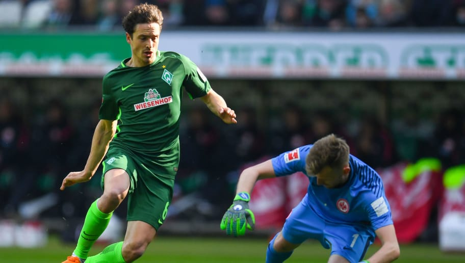 Frankfurt's Finnish goalkeeper Lukas Hradecky (R) and Bremen's Danish midfielder Thomas Delaney vie for the ball during the German first division Bundesliga football match Werder Bremen vs Eintracht Frankfurt, in Bremen, northern Germany, on April 1, 2018. / AFP PHOTO / Patrik STOLLARZ / RESTRICTIONS: DURING MATCH TIME: DFL RULES TO LIMIT THE ONLINE USAGE TO 15 PICTURES PER MATCH AND FORBID IMAGE SEQUENCES TO SIMULATE VIDEO. == RESTRICTED TO EDITORIAL USE == FOR FURTHER QUERIES PLEASE CONTACT DFL DIRECTLY AT + 49 69 650050         (Photo credit should read PATRIK STOLLARZ/AFP/Getty Images)