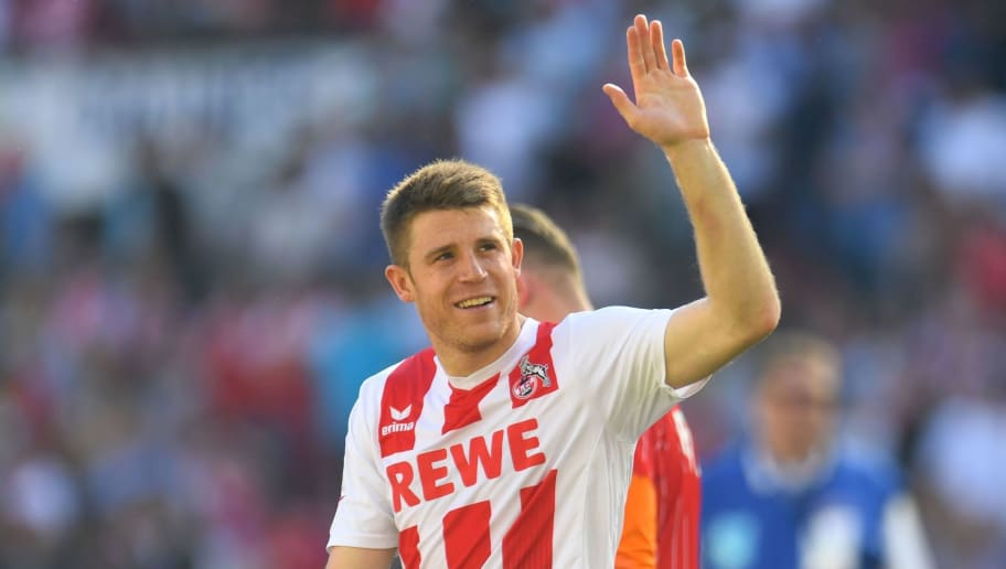 Cologne's German defender Dominique Heintz (C) waves at the end of the German first division Bundesliga football match FC Cologne vs FC Bayern Munich in Cologne, western Germany, on May 5, 2018. - Bundesliga champions Bayern Munich needed rapid-fire goals from James Rodriguez and Robert Lewandowski to seal a 3-1 come-back win at bottom side Cologne, who are already relegated. (Photo by Patrik STOLLARZ / AFP) / RESTRICTIONS: DURING MATCH TIME: DFL RULES TO LIMIT THE ONLINE USAGE TO 15 PICTURES PER MATCH AND FORBID IMAGE SEQUENCES TO SIMULATE VIDEO. == RESTRICTED TO EDITORIAL USE == FOR FURTHER QUERIES PLEASE CONTACT DFL DIRECTLY AT + 49 69 650050        (Photo credit should read PATRIK STOLLARZ/AFP/Getty Images)