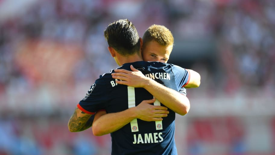 Bayern Munich's Colombian midfielder James Rodriguez and Bayern Munich's German midfielder Joshua Kimmich  embrace after the German first division Bundesliga football match 1. FC Cologne vs Bayern Munich, in Cologne, western Germany, on May 5, 2018. (Photo by Patrik STOLLARZ / AFP) / RESTRICTIONS: DURING MATCH TIME: DFL RULES TO LIMIT THE ONLINE USAGE TO 15 PICTURES PER MATCH AND FORBID IMAGE SEQUENCES TO SIMULATE VIDEO. == RESTRICTED TO EDITORIAL USE == FOR FURTHER QUERIES PLEASE CONTACT DFL DIRECTLY AT + 49 69 650050        (Photo credit should read PATRIK STOLLARZ/AFP/Getty Images)
