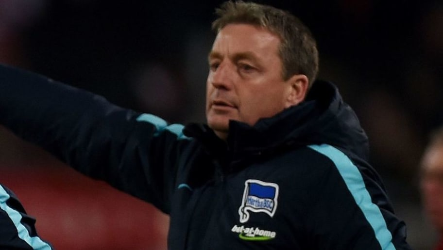 Hertha's Hungarian head coach Pal Dardai (L) reacts next to his assistant Rainer Widmayer during the German first division Bundesliga football match 1 FC Cologne vs Hertha Berlin in Cologne, western Germany, on February 26, 2016.    / AFP / PATRIK STOLLARZ / RESTRICTIONS: DURING MATCH TIME: DFL RULES TO LIMIT THE ONLINE USAGE TO 15 PICTURES PER MATCH AND FORBID IMAGE SEQUENCES TO SIMULATE VIDEO. == RESTRICTED TO EDITORIAL USE == FOR FURTHER QUERIES PLEASE CONTACT DFL DIRECTLY AT + 49 69 650050         (Photo credit should read PATRIK STOLLARZ/AFP/Getty Images)