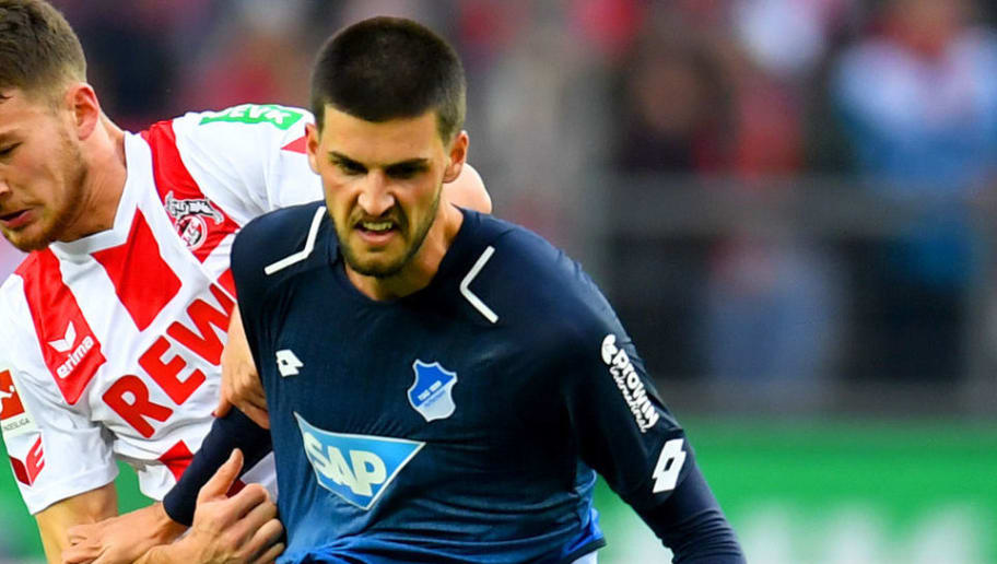 Cologne's German midfielder Salih Ozcan (R) and Hoffenheim's Austrian midfielder Florian Grillitsch vie for the ball during the German first division Bundesliga football match FC Cologne vs 1899 Hoffenheim in Cologne, western Germany, on November 5, 2017. / AFP PHOTO / PATRIK STOLLARZ / RESTRICTIONS: DURING MATCH TIME: DFL RULES TO LIMIT THE ONLINE USAGE TO 15 PICTURES PER MATCH AND FORBID IMAGE SEQUENCES TO SIMULATE VIDEO. == RESTRICTED TO EDITORIAL USE == FOR FURTHER QUERIES PLEASE CONTACT DFL DIRECTLY AT + 49 69 650050         (Photo credit should read PATRIK STOLLARZ/AFP/Getty Images)