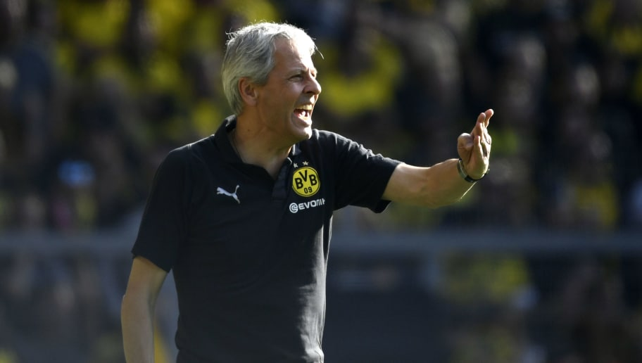 Dortmund's coach Lucien Favre gestures during the German first division Bundesliga football match Borussia Dortmund vs FC Augsburg in Dortmund, western Germany, on October 6, 2018. (Photo by INA FASSBENDER / AFP) / RESTRICTIONS: DFL REGULATIONS PROHIBIT ANY USE OF PHOTOGRAPHS AS IMAGE SEQUENCES AND/OR QUASI-VIDEO        (Photo credit should read INA FASSBENDER/AFP/Getty Images)