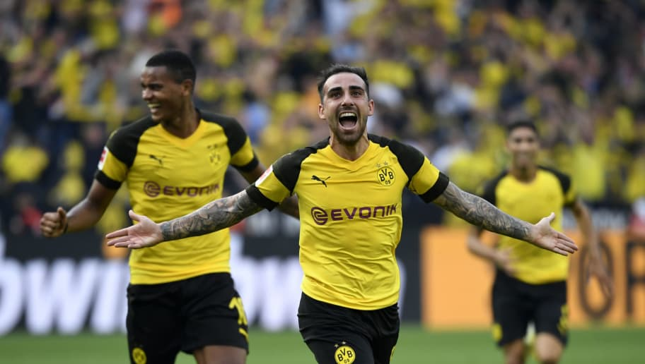 Dortmund's Spanish forward Paco Alcacer and Dortmund's French defender Abdou Diallo (L) celebrate scoring the 4-3 against Augsburg during the German first division Bundesliga football match Borussia Dortmund vs FC Augsburg in Dortmund, western Germany, on October 6, 2018. (Photo by INA FASSBENDER / AFP) / RESTRICTIONS: DFL REGULATIONS PROHIBIT ANY USE OF PHOTOGRAPHS AS IMAGE SEQUENCES AND/OR QUASI-VIDEO        (Photo credit should read INA FASSBENDER/AFP/Getty Images)