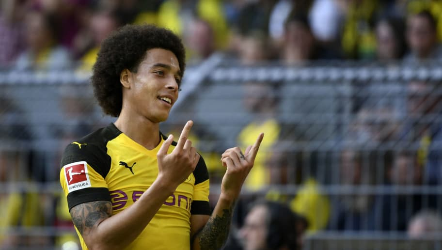 Dortmund's Belgian midfielder Axel Witsel gestures during the German first division Bundesliga football match Borussia Dortmund vs FC Augsburg in Dortmund, western Germany, on October 6, 2018. (Photo by INA FASSBENDER / AFP) / RESTRICTIONS: DFL REGULATIONS PROHIBIT ANY USE OF PHOTOGRAPHS AS IMAGE SEQUENCES AND/OR QUASI-VIDEO        (Photo credit should read INA FASSBENDER/AFP/Getty Images)