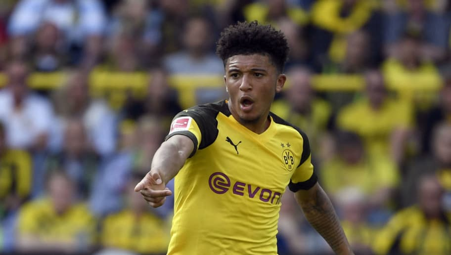 Dortmund's English midfielder Jadon Sancho plays the ball during the German first division Bundesliga football match Borussia Dortmund vs FC Augsburg in Dortmund, western Germany, on October 6, 2018. (Photo by INA FASSBENDER / AFP) / RESTRICTIONS: DFL REGULATIONS PROHIBIT ANY USE OF PHOTOGRAPHS AS IMAGE SEQUENCES AND/OR QUASI-VIDEO        (Photo credit should read INA FASSBENDER/AFP/Getty Images)