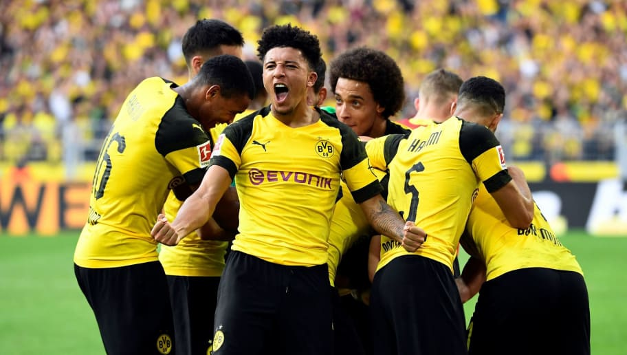 Dortmund's English midfielder Jadon Sancho (C) celebrates with team mates the victory over Augsburg during the German first division Bundesliga football match Borussia Dortmund vs FC Augsburg in Dortmund, western Germany, on October 6, 2018. (Photo by INA FASSBENDER / AFP) / RESTRICTIONS: DFL REGULATIONS PROHIBIT ANY USE OF PHOTOGRAPHS AS IMAGE SEQUENCES AND/OR QUASI-VIDEO        (Photo credit should read INA FASSBENDER/AFP/Getty Images)
