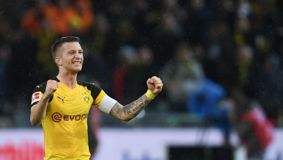 Dortmund's German forward Marco Reus reacts after the German first division Bundesliga football match BVB Borussia Dortmund v FC Bayern Munich in Dortmund, western Germany, on November 10, 2018. (Photo by Patrik STOLLARZ / AFP) / RESTRICTIONS: DFL REGULATIONS PROHIBIT ANY USE OF PHOTOGRAPHS AS IMAGE SEQUENCES AND/OR QUASI-VIDEO        (Photo credit should read PATRIK STOLLARZ/AFP/Getty Images)