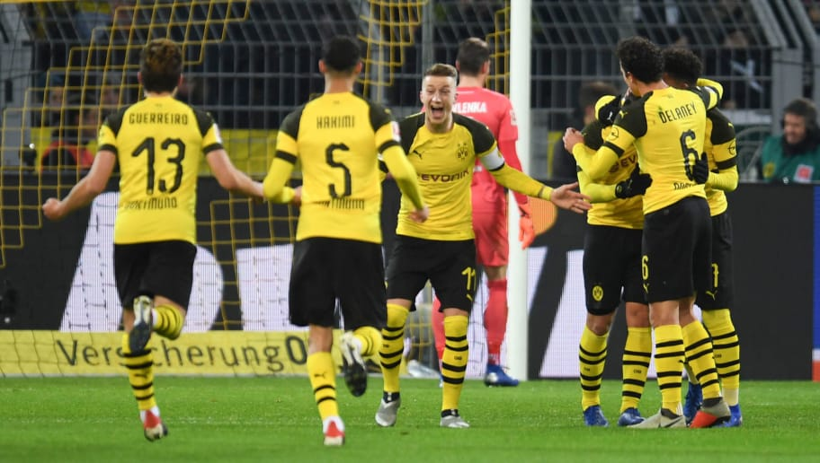 Dortmund's German forward Marco Reus and his teammates celebrate after scoring during the German first division Bundesliga football match Borussia Dortmund vs Werder Bremen in Dortmund, western Germany, on December 15, 2018. (Photo by Patrik STOLLARZ / AFP) / RESTRICTIONS: DFL REGULATIONS PROHIBIT ANY USE OF PHOTOGRAPHS AS IMAGE SEQUENCES AND/OR QUASI-VIDEO        (Photo credit should read PATRIK STOLLARZ/AFP/Getty Images)