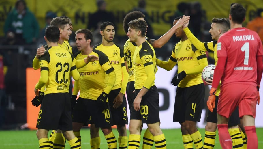 Dortmund's players celebrate during the German first division Bundesliga football match Borussia Dortmund vs Werder Bremen in Dortmund, western Germany, on December 15, 2018. (Photo by Patrik STOLLARZ / AFP) / RESTRICTIONS: DFL REGULATIONS PROHIBIT ANY USE OF PHOTOGRAPHS AS IMAGE SEQUENCES AND/OR QUASI-VIDEO        (Photo credit should read PATRIK STOLLARZ/AFP/Getty Images)
