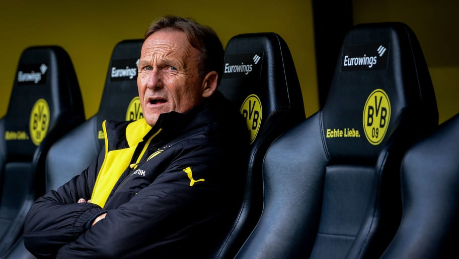 CEO of borussia Dortmund Hans Joachim Watzke is seen before the German First division Bundesliga football match between Borussia Dortmund and Eintracht Frankfurt in Dortmund, western Germany, on April 15, 2017. / AFP PHOTO / SASCHA SCHUERMANN / RESTRICTIONS: DURING MATCH TIME: DFL RULES TO LIMIT THE ONLINE USAGE TO 15 PICTURES PER MATCH AND FORBID IMAGE SEQUENCES TO SIMULATE VIDEO. == RESTRICTED TO EDITORIAL USE == FOR FURTHER QUERIES PLEASE CONTACT DFL DIRECTLY AT + 49 69 650050         (Photo credit should read SASCHA SCHUERMANN/AFP/Getty Images)