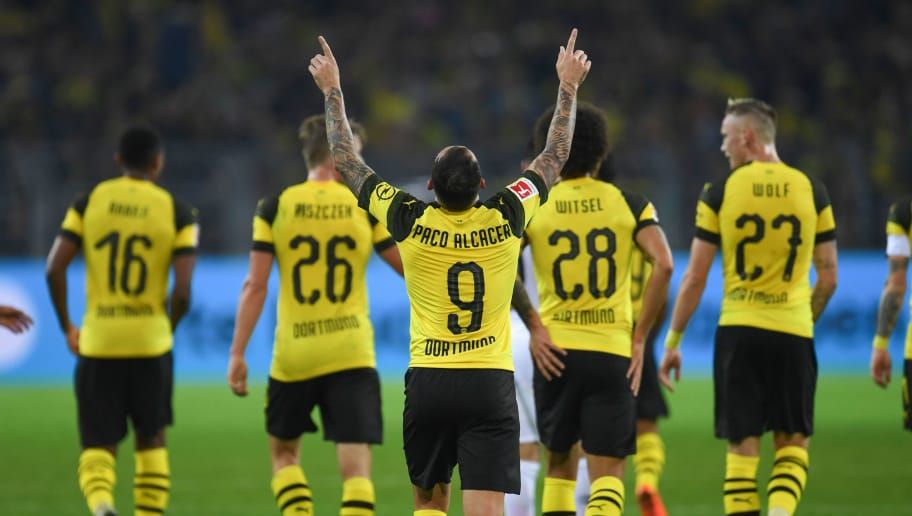 Dortmund's midfielder Paco Alacer celebrates with his teammates after scoring during the German first division Bundesliga football match Borussia Dortmund v Eintracht Frankfurt in Dortmund, western Germany, on September 14, 2018. (Photo by Patrik STOLLARZ / AFP) / RESTRICTIONS: DFL REGULATIONS PROHIBIT ANY USE OF PHOTOGRAPHS AS IMAGE SEQUENCES AND/OR QUASI-VIDEO        (Photo credit should read PATRIK STOLLARZ/AFP/Getty Images)