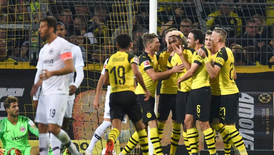 Dortmund's French defender Abdou Diallo celebrates scoring the opening goal with his teammates during the German first division Bundesliga football match Borussia Dortmund v Eintracht Frankfurt in Dortmund, western Germany, on September 14, 2018. (Photo by Patrik STOLLARZ / AFP) / RESTRICTIONS: DFL REGULATIONS PROHIBIT ANY USE OF PHOTOGRAPHS AS IMAGE SEQUENCES AND/OR QUASI-VIDEO        (Photo credit should read PATRIK STOLLARZ/AFP/Getty Images)
