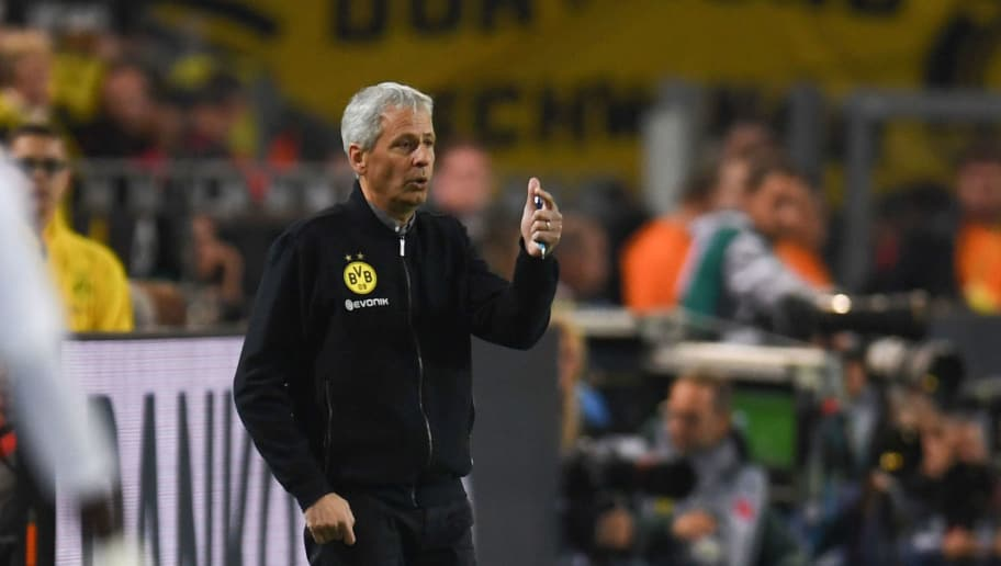 Dortmund's Swiss head coach Lucien Favre reacts during the German first division Bundesliga football match Borussia Dortmund v Eintracht Frankfurt in Dortmund, western Germany, on September 14, 2018. (Photo by Patrik STOLLARZ / AFP) / RESTRICTIONS: DFL REGULATIONS PROHIBIT ANY USE OF PHOTOGRAPHS AS IMAGE SEQUENCES AND/OR QUASI-VIDEO        (Photo credit should read PATRIK STOLLARZ/AFP/Getty Images)