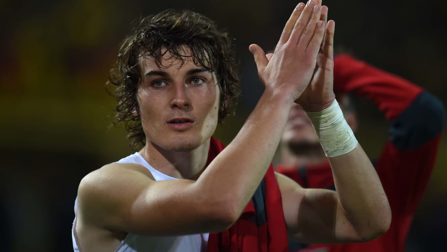 Freiburg´s Turkish defender Caglar Soyuncu reacts after the German first division Bundesliga football match of Borussia Dortmund vs SC Freiburg in Dortmund, western Germany, on September 23, 2016. / AFP / PATRIK STOLLARZ / RESTRICTIONS: DURING MATCH TIME: DFL RULES TO LIMIT THE ONLINE USAGE TO 15 PICTURES PER MATCH AND FORBID IMAGE SEQUENCES TO SIMULATE VIDEO. == RESTRICTED TO EDITORIAL USE == FOR FURTHER QUERIES PLEASE CONTACT DFL DIRECTLY AT + 49 69 650050         (Photo credit should read PATRIK STOLLARZ/AFP/Getty Images)