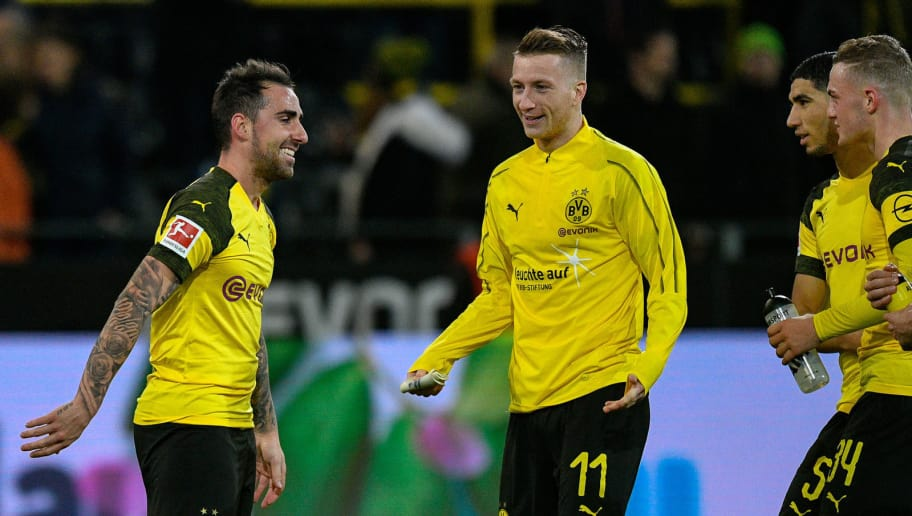 Dortmund's midfielder Alcacer Paco and Dortmund's forward Marco Reus celebrate after scoring during the German first division Bundesliga football match between Borussia Dortmund and SC Freiburg in Dortmund, western Germany on December 1, 2018. (Photo by SASCHA SCHUERMANN / AFP) / RESTRICTIONS: DFL REGULATIONS PROHIBIT ANY USE OF PHOTOGRAPHS AS IMAGE SEQUENCES AND/OR QUASI-VIDEO        (Photo credit should read SASCHA SCHUERMANN/AFP/Getty Images)