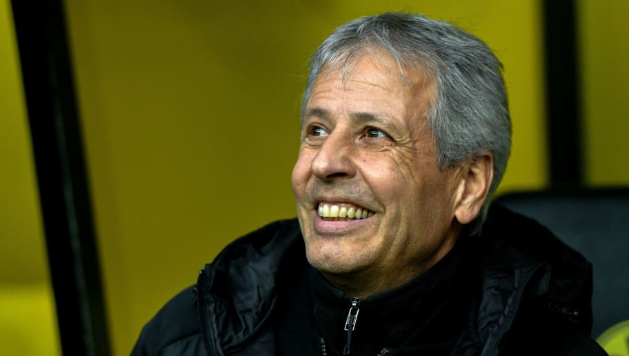 Dortmund's head coach Lucien Favre smiles on the bench before the German first division Bundesliga football match between Borussia Dortmund and SC Freiburg in Dortmund, western Germany on December 1, 2018. (Photo by SASCHA SCHUERMANN / AFP) / RESTRICTIONS: DFL REGULATIONS PROHIBIT ANY USE OF PHOTOGRAPHS AS IMAGE SEQUENCES AND/OR QUASI-VIDEO        (Photo credit should read SASCHA SCHUERMANN/AFP/Getty Images)