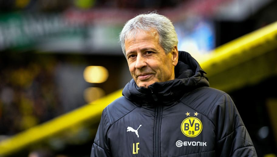 Dortmund's head coach Lucien Favre arrives for the German first division Bundesliga football match between Borussia Dortmund and SC Freiburg in Dortmund, western Germany on December 1, 2018. (Photo by SASCHA SCHUERMANN / AFP) / RESTRICTIONS: DFL REGULATIONS PROHIBIT ANY USE OF PHOTOGRAPHS AS IMAGE SEQUENCES AND/OR QUASI-VIDEO        (Photo credit should read SASCHA SCHUERMANN/AFP/Getty Images)