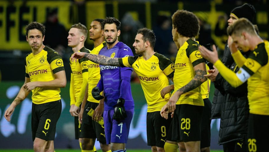 Dortmund's players, including Danish midfielder Thomas Delaney (L), panish forward Paco Alcacer (3rdR) and Swiss goalkeeper Roman Buerki (C) celebrate their victory at the end of the German first division Bundesliga football match between Borussia Dortmund and SC Freiburg in Dortmund, western Germany on December 1, 2018. (Photo by SASCHA SCHUERMANN / AFP) / RESTRICTIONS: DFL REGULATIONS PROHIBIT ANY USE OF PHOTOGRAPHS AS IMAGE SEQUENCES AND/OR QUASI-VIDEO        (Photo credit should read SASCHA SCHUERMANN/AFP/Getty Images)