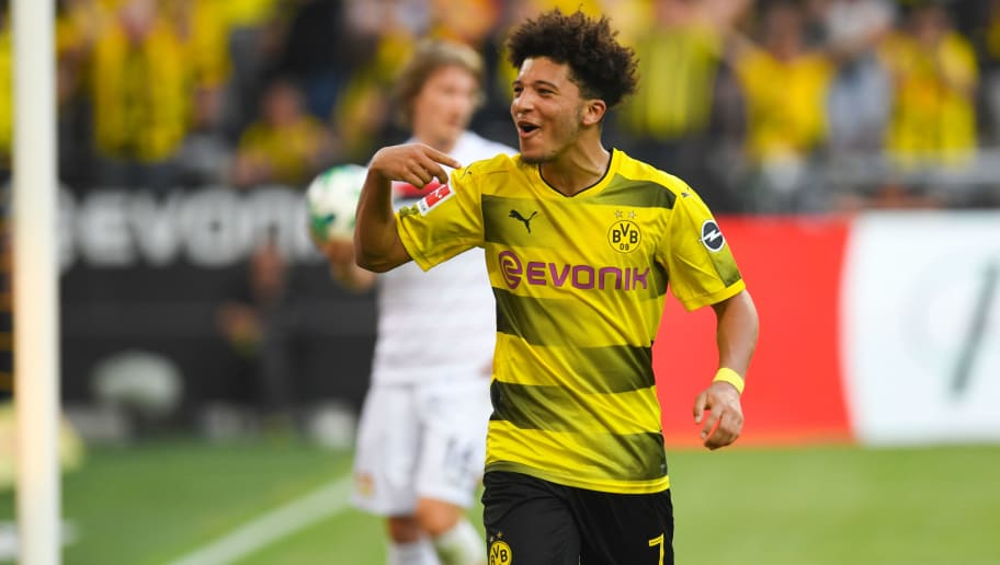 Dortmund's English midfielder Jadon Sancho celebrates after scoring during the German first division Bundesliga football match Borussia Dortmund vs Bayer Leverkusen, in Dortmund, western Germany, on April 21, 2018. (Photo by Patrik STOLLARZ / AFP) / RESTRICTIONS: DURING MATCH TIME: DFL RULES TO LIMIT THE ONLINE USAGE TO 15 PICTURES PER MATCH AND FORBID IMAGE SEQUENCES TO SIMULATE VIDEO. == RESTRICTED TO EDITORIAL USE == FOR FURTHER QUERIES PLEASE CONTACT DFL DIRECTLY AT + 49 69 650050        (Photo credit should read PATRIK STOLLARZ/AFP/Getty Images)