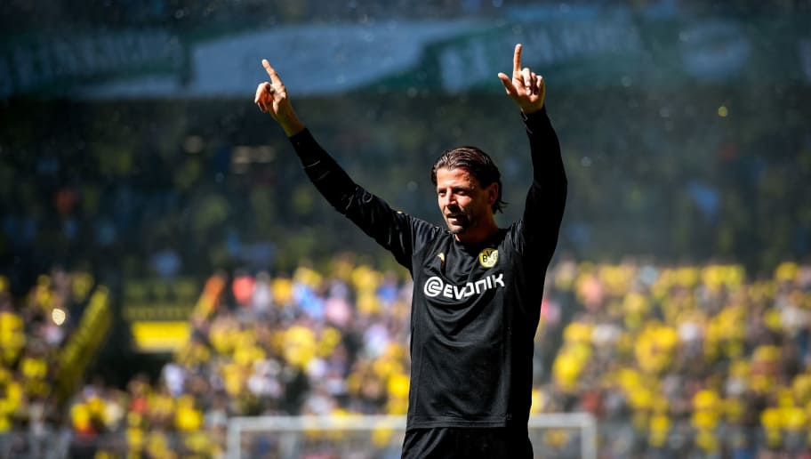 Dortmund's goalkeeper Roman Weidenfeller says farewell after the German first division Bundesliga football match Borussia Dortmund vs Mainz 05 in Dortmund, western Germany, on May 5, 2018. (Photo by SASCHA SCHUERMANN / AFP) / RESTRICTIONS: DURING MATCH TIME: DFL RULES TO LIMIT THE ONLINE USAGE TO 15 PICTURES PER MATCH AND FORBID IMAGE SEQUENCES TO SIMULATE VIDEO. == RESTRICTED TO EDITORIAL USE == FOR FURTHER QUERIES PLEASE CONTACT DFL DIRECTLY AT + 49 69 650050        (Photo credit should read SASCHA SCHUERMANN/AFP/Getty Images)