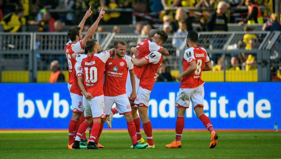 Mainz' players celebrate after winning the German first division Bundesliga football match Borussia Dortmund vs Mainz 05 in Dortmund, western Germany, on May 5, 2018. - Mainz won 2-1. (Photo by SASCHA SCHUERMANN / AFP) / RESTRICTIONS: DURING MATCH TIME: DFL RULES TO LIMIT THE ONLINE USAGE TO 15 PICTURES PER MATCH AND FORBID IMAGE SEQUENCES TO SIMULATE VIDEO. == RESTRICTED TO EDITORIAL USE == FOR FURTHER QUERIES PLEASE CONTACT DFL DIRECTLY AT + 49 69 650050        (Photo credit should read SASCHA SCHUERMANN/AFP/Getty Images)