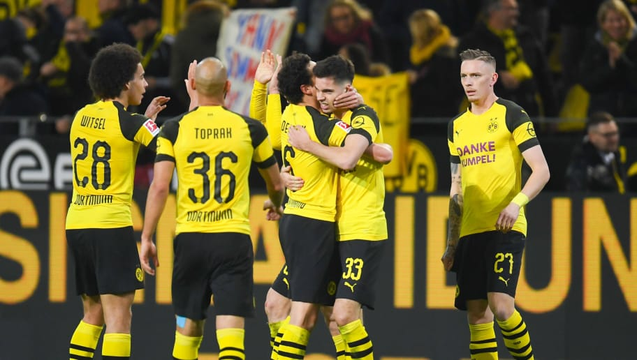Dortmund's players celebrate during the German First division Bundesliga football match between Borussia Dortmund and Borussia Moenchengladbach in Dortmund, western Germany, on December 21, 2018. (Photo by Patrik STOLLARZ / AFP) / DFL REGULATIONS PROHIBIT ANY USE OF PHOTOGRAPHS AS IMAGE SEQUENCES AND/OR QUASI-VIDEO        (Photo credit should read PATRIK STOLLARZ/AFP/Getty Images)