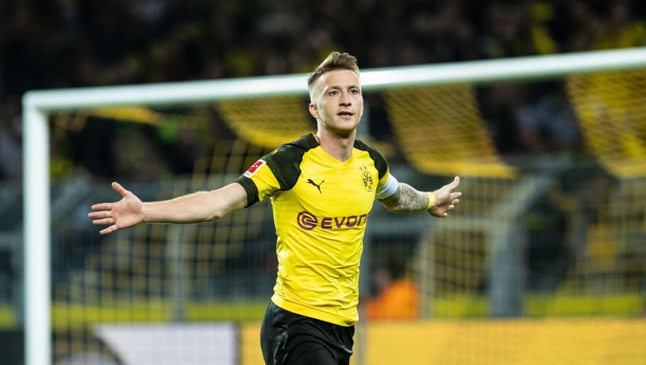 Dortmund's German forward Marco Reus celebrates scoring his team's second goal during the German first division Bundesliga football match Borussia Dortmund vs 1. FC Nuremberg in Dortmund, westhern Germany, on September 26, 2018. (Photo by Bernd Thissen / dpa / AFP) / RESTRICTIONS: DFL REGULATIONS PROHIBIT ANY USE OF PHOTOGRAPHS AS IMAGE SEQUENCES AND/OR QUASI-VIDEO        (Photo credit should read BERND THISSEN/AFP/Getty Images)