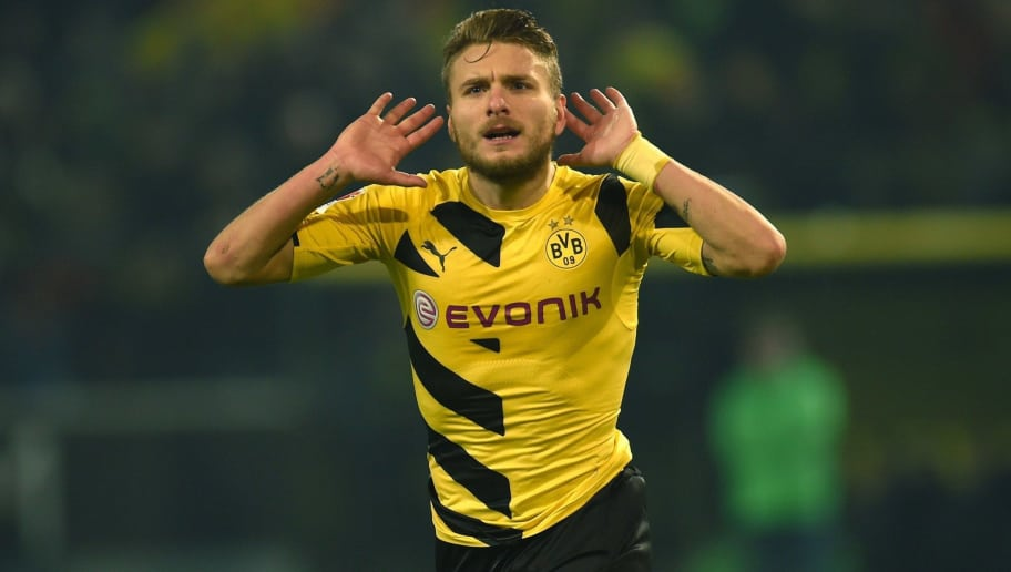 Dortmund's Italian striker Ciro Immobile celebrates during the German First division Bundesliga football match Borussia Dortmund v VfL Wolfsburg in Dortmund, Germany, on December 17, 2014.  AFP PHOTO / PATRIK STOLLARZ  RESTRICTIONS - DFL RULES TO LIMIT THE ONLINE USAGE DURING MATCH TIME TO 15 PICTURES PER MATCH. FOR FURTHER QUERIES PLEASE CONTACT DFL DIRECTLY AT + 49 69 650050        (Photo credit should read PATRIK STOLLARZ/AFP/Getty Images)