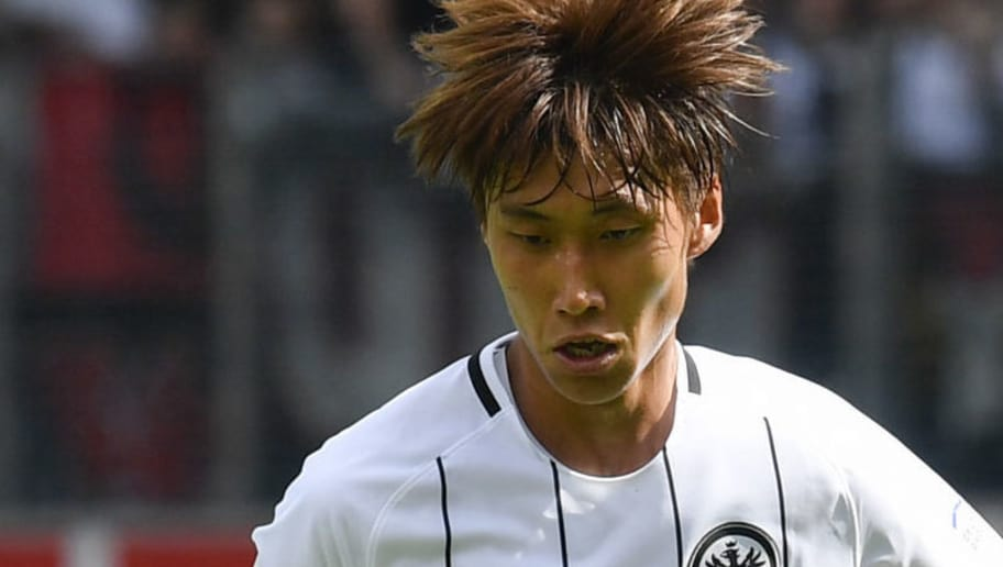 Frankfurt's Japanese midfielder Daichi Kamada controls the ball during the German First division Bundesliga football match SC Freiburg v Eintracht Frankfurt in Freiburg, southern Germany on August 20, 2017. / AFP PHOTO / THOMAS KIENZLE / RESTRICTIONS: DURING MATCH TIME: DFL RULES TO LIMIT THE ONLINE USAGE TO 15 PICTURES PER MATCH AND FORBID IMAGE SEQUENCES TO SIMULATE VIDEO. == RESTRICTED TO EDITORIAL USE == FOR FURTHER QUERIES PLEASE CONTACT DFL DIRECTLY AT + 49 69 650050         (Photo credit should read THOMAS KIENZLE/AFP/Getty Images)