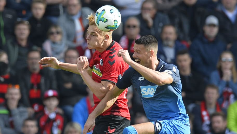 Freiburg's  Austrian defender Philipp Lienhart (L) and Hoffenheim's German forward Sandro Wagner vie for the ball during the German first division Bundesliga football match SC Freiburg vs TSG 1899 Hoffenheim in Freiburg, southwestern Germany, on October 1, 2017. / AFP PHOTO / THOMAS KIENZLE / RESTRICTIONS: DURING MATCH TIME: DFL RULES TO LIMIT THE ONLINE USAGE TO 15 PICTURES PER MATCH AND FORBID IMAGE SEQUENCES TO SIMULATE VIDEO. == RESTRICTED TO EDITORIAL USE == FOR FURTHER QUERIES PLEASE CONTACT DFL DIRECTLY AT + 49 69 650050         (Photo credit should read THOMAS KIENZLE/AFP/Getty Images)