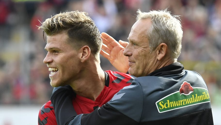 Freiburg's German head coach Christian Streich (R) and Freiburg's German forward Florian Niederlechner react after the German first division Bundesliga football match SC Freiburg vs TSG 1899 Hoffenheim in Freiburg, southwestern Germany, on October 1, 2017. / AFP PHOTO / THOMAS KIENZLE / RESTRICTIONS: DURING MATCH TIME: DFL RULES TO LIMIT THE ONLINE USAGE TO 15 PICTURES PER MATCH AND FORBID IMAGE SEQUENCES TO SIMULATE VIDEO. == RESTRICTED TO EDITORIAL USE == FOR FURTHER QUERIES PLEASE CONTACT DFL DIRECTLY AT + 49 69 650050         (Photo credit should read THOMAS KIENZLE/AFP/Getty Images)