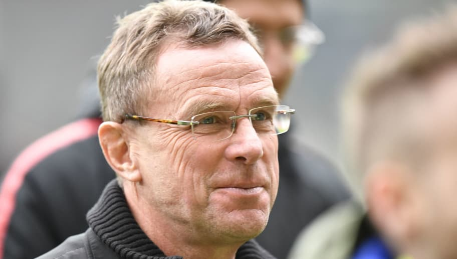 Leipzig's head coach Ralf Rangnick inspects the lawn before the German first division Bundesliga football match SC Freiburg vs RB Leipzig on December 8, 2018 in Freiburg. (Photo by THOMAS KIENZLE / AFP) / RESTRICTIONS: DFL REGULATIONS PROHIBIT ANY USE OF PHOTOGRAPHS AS IMAGE SEQUENCES AND/OR QUASI-VIDEO        (Photo credit should read THOMAS KIENZLE/AFP/Getty Images)