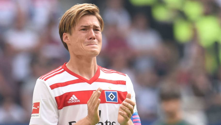 Hamburg's Japanese defender Gotoku Sakai reacts on the pitch after the German first division Bundesliga football match Hamburger SV vs Borussia Moenchengladbach, in Hamburg, nothern Germany, on May 12, 2018. (Photo by Patrik STOLLARZ / AFP) / RESTRICTIONS: DURING MATCH TIME: DFL RULES TO LIMIT THE ONLINE USAGE TO 15 PICTURES PER MATCH AND FORBID IMAGE SEQUENCES TO SIMULATE VIDEO. == RESTRICTED TO EDITORIAL USE == FOR FURTHER QUERIES PLEASE CONTACT DFL DIRECTLY AT + 49 69 650050        (Photo credit should read PATRIK STOLLARZ/AFP/Getty Images)
