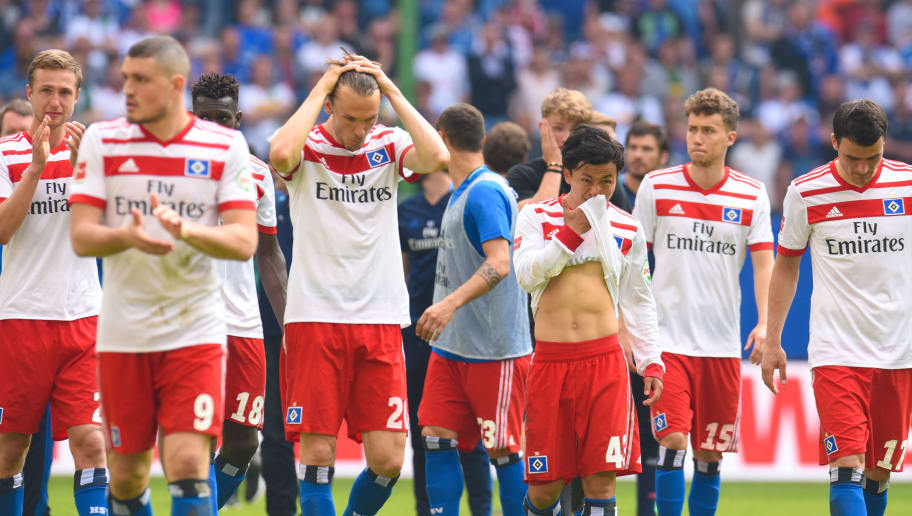Hamburg's players leave the pitch after the German first division Bundesliga football match Hamburger SV vs Borussia Moenchengladbach, in Hamburg, nothern Germany, on May 12, 2018. (Photo by Patrik STOLLARZ / AFP) / RESTRICTIONS: DURING MATCH TIME: DFL RULES TO LIMIT THE ONLINE USAGE TO 15 PICTURES PER MATCH AND FORBID IMAGE SEQUENCES TO SIMULATE VIDEO. == RESTRICTED TO EDITORIAL USE == FOR FURTHER QUERIES PLEASE CONTACT DFL DIRECTLY AT + 49 69 650050        (Photo credit should read PATRIK STOLLARZ/AFP/Getty Images)